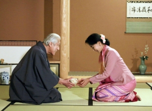 Myanmar democracy activist Aung San Suu Kyi (right) receives a bowl of green tea from Japanese tea master Genshitsu Sen at a tea ceremony in Kyoto during a 2013 visit to Japan